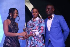 Thelma Chukwu of Nestoil presenting award for best company in CSR Sustainability, West Africa to Ijeoma Aso, Managing Director, UBA Foundation while Olusegun Fafore, Corporate Communications Manager, Nest Oil,  looks on...at the 2016 SERAS CSR Awards -Africa in Lagos, during the weekend.
