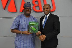 l-r: Founder Naija Green Card, Abimbola Daramola  and Head Digital & Consumer Banking, United Bank for Africa (UBA) Group, Mr.  Yinka Adedeji, during the official launch of the Naija Green Card Prepaid Card at the UBA house, Lagos